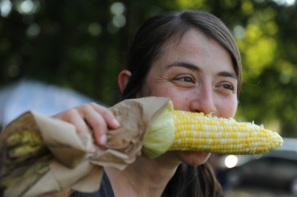 Gore Place employee Natalie Brubaker, of Cambridge, tries some roasted corn during the estate's corn harvest event, Aug. 14, 2015. The event will also take place on Aug. 21 and 28.<br /> Wicked Local staff photo / Kate Flock
