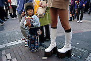Walking in Tokyo's hip Harajuku area, a young girl clutches a kurepu (a crepe). Hungry Planet: What the World Eats (p. 184). This image is featured alongside the Ukita family images in Hungry Planet: What the World Eats.