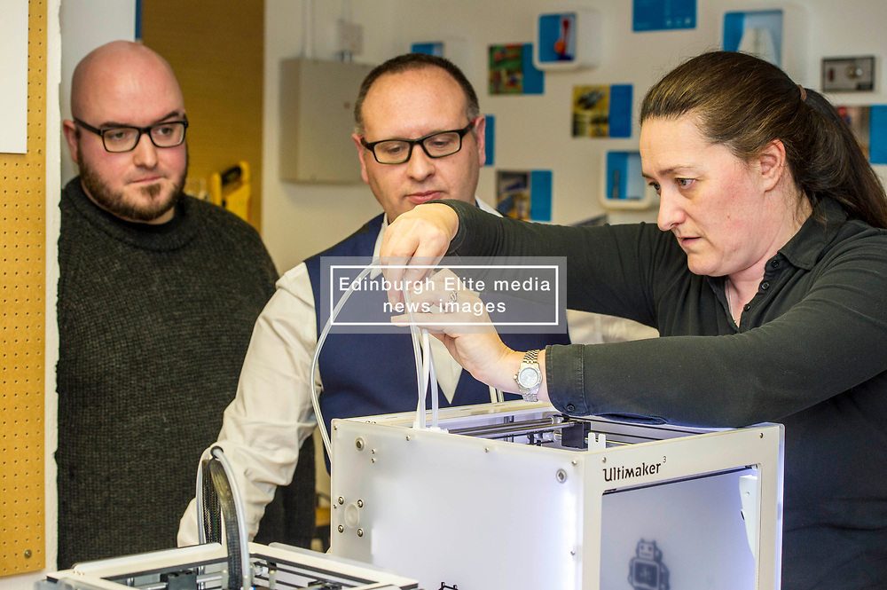 Pictured: Stuart Brown (white shirt) Head of SME Barclays banking, Scotland and Stephen Coleman, CEO and founder of Codebase watch as engineer Sharon Jones, ensures the 3-d printer is operational.<br /> Today Keith Brown MSP opened Scotland's first Barclays Eagle lab in partnership with CodeBase. The resource allows businesses and communities to access new technologies and boost digital skills while supporting job creation in the local economy. <br /> <br /> Ger Harley | EEm 16 January 2018