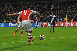 Arsenal's Lukas Podolski scores - Photo mandatory by-line: Dougie Allward/JMP - Mobile: 07966 386802 - 22/10/2014 - SPORT - Football - Anderlecht - Constant Vanden Stockstadion - R.S.C. Anderlecht v Arsenal - UEFA Champions League - Group D