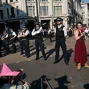 Oxford Circus. For up to ten days Extinction Rebellion activists occupied Waterloo Bridge, Parliament Square, Oxford Circus and Marble Arch disrupting traffic and 'normal life'. More than a thousand people were arrested before the police finally cleared the street and the International Rebellion was called to halt by the activists.  The environmental protest group Extinction Rebellion has called for civil disobedience and peaceful protest to force the British government to take drastic action on climate change. The group wants the government to tell the truth and admit that the impact of climate change is much more severe than they say and that action to mitigate catastrophic climate change is urgent.