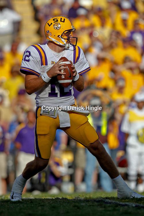 October 8, 2011; Baton Rouge, LA, USA;  LSU Tigers quarterback Jarrett Lee (12) against the Florida Gators during the second half at Tiger Stadium. LSU defeated Florida 41-11. Mandatory Credit: Derick E. Hingle-US PRESSWIRE / © Derick E. Hingle 2011