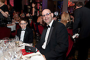 WILL COBEN; HARLAN COBEN TRYING ON THEIR FREE SPECTACLES, Specsavers Crime Thriller Awards.  Award ceremony celebrating the best in crime fiction and television. <br /> Grosvenor House Hotel, Park Lane, London. 21 October 2009