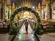 27 MARCH 2016 - BANGKOK, THAILAND: A person walks into  Santa Cruz Church in Bangkok for Easter services. Santa Cruz was one of the first Catholic churches established in Bangkok. It was built in the late 1700s by Portuguese soldiers allied with King Taksin the Great in his battles against the Burmese who invaded Thailand (then Siam). There are about 300,000 Catholics in Thailand, in 10 dioceses with 436 parishes. Easter marks the resurrection of Jesus after his crucifixion and is celebrated in Christian communities around the world.      PHOTO BY JACK KURTZ