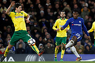Michy Batshuayi of Chelsea (R) in action with Timm Klose of Norwich City (L). The Emirates FA Cup, 3rd round replay match, Chelsea v Norwich City at Stamford Bridge in London on Wednesday 17th January 2018.<br /> pic by Steffan Bowen, Andrew Orchard sports photography.