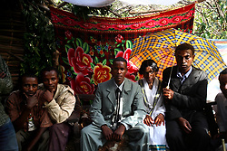 Tsegaya, 13, and Talema, 23, sit together for the first time as husband and wife in Yeganda Village, Amhara Region, Ethopia on May 20, 2007. The practice of early marriage remains widespread in Ethiopia, especially in the northern Amhara and Tigray regions, where parents consent to their daughters' consummated marriages when they are still as young as 10 or 12. In Amhara, 50 percent of girls are married by the age of 15, despite the enactment in 2000 of the revised Family Law, which sets the legal age for marriage at 18.