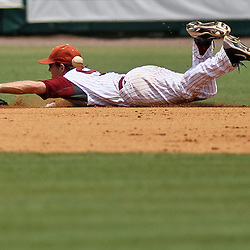 June 05, 2011; Tallahassee, FL, USA; Alabama Crimson Tide short stop Jared Reaves (9) dives to make a stop during the fifth inning of the Tallahassee regional of the 2011 NCAA baseball tournament against the UCF Knights at Dick Howser Stadium. Alabama defeated UCF 12-5. Mandatory Credit: Derick E. Hingle