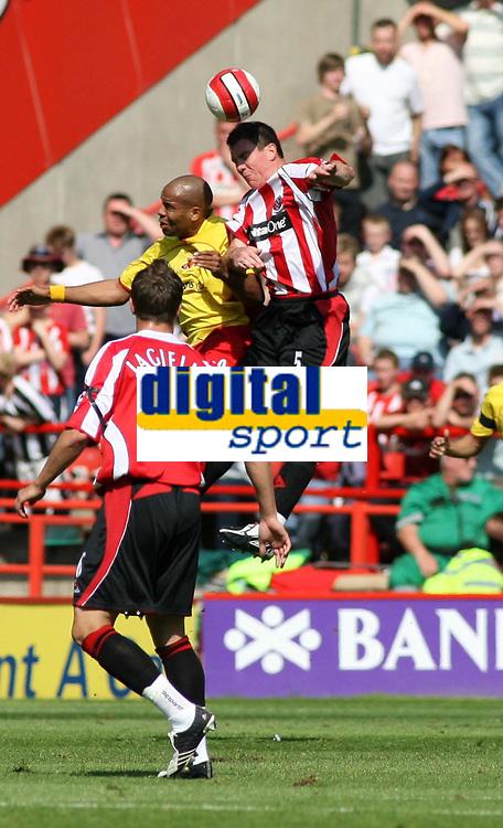 Photo: Mark Stephenson.<br /> Sheffield United v Watford. The Barclays Premiership. 28/04/2007.Sheffield's Chris Morgan (R) heads the ball