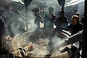 worshipers wave smoke over their bodies to heal or prevent illness Asakusa Kannon Temple Tokyo