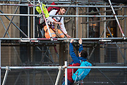 Activists from the group Action for Climate Truth and Reparations (ACTR) climb scaffolding to hang an open letter to the UK people from Africans Rising For Justice, Peace and Dignity from the Houses of Parliament on 12 November 2020 in London, United Kingdom. The letter, which launches Africans Rising's ReRight History campaign, contains a plea to the UK people to start making amends for the harm caused by slavery and colonialism.
