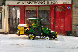 Edinburgh, Scotland, UK. 10 Feb 2021. Big freeze continues in the UK with heavy overnight and morning snow bringing traffic to a standstill on many roads in the city centre. Pic; Small tractor snowplough and glitter on pavement in Grassmarket . Iain Masterton/Alamy Live news