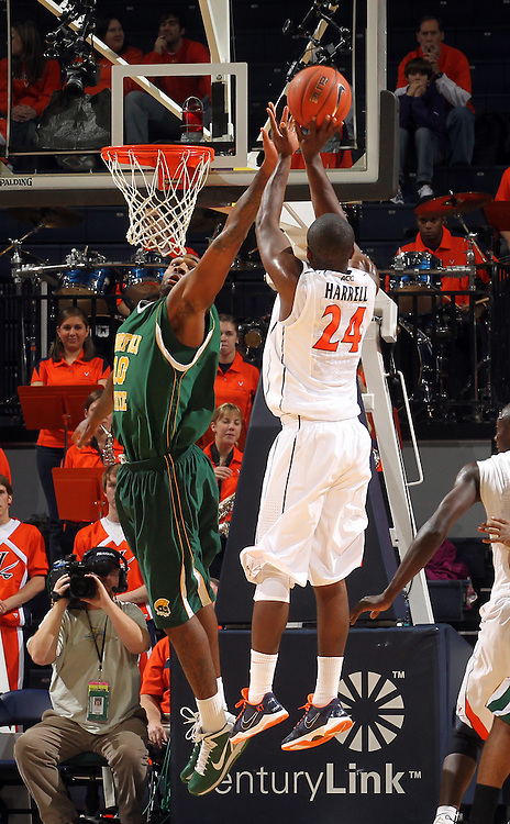 Dec. 20, 2010; Charlottesville, VA, USA; Virginia Cavaliers guard K.T. Harrell (24) shoots over Norfolk State Spartans forward Kyle O'Quinn (10) during the game at the John Paul Jones Arena. Mandatory Credit: Andrew Shurtleff