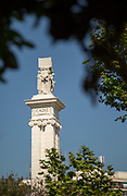 View of monument seen through branches, Cadiz, Andalusia, Spain