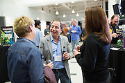 TAOS employees and partners celebrate and socialize during the TAOS 25th Anniversary Event at the Computer History Museum in Mountain View, California, on November 5, 2014. (Stan Olszewski/SOSKIphoto)