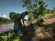 The women of the Nate family coming back on canoe from gathering plantain and Manioc at a nearby field.
