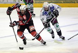 Anze Terlikar vs Matej Hocevar at 52nd round of EBEL league ice hockey match between HK Acroni Jesenice and HDD Tilia Olimpija, on January 29, 2009, in Podmezaklja, Jesenice, Slovenia. Acroni Jesenice won 5:3. (Photo by Vid Ponikvar / Sportida)