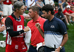 June 24, 2018 - Cromwell, Connecticut, United States - Bubba Watson (R) and his caddie Ted Scott on the 18th green after the final round of the Travelers Championship at TPC River Highlands. (Credit Image: © Debby Wong via ZUMA Wire)