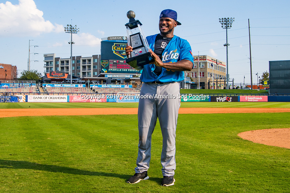 Amarillo Sod Poodles pitcher Carlos Belen (50) poses with the trophy after the Sod Poodles won against the Tulsa Drillers during the Texas League Championship on Sunday, Sept. 15, 2019, at OneOK Field in Tulsa, Oklahoma. [Photo by John Moore/Amarillo Sod Poodles]
