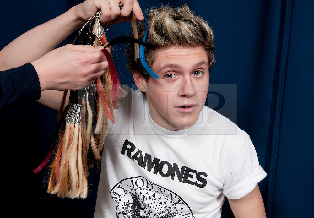© Licensed to London News Pictures. 07/01/2013. London, UK Niall Horan gets measured for the waxwork model of himself. Madame Tussauds today, 11th March 2013, confirmed all five members of the successful band, One Direction, are to be created as wax figures for a touring attraction in three Madame Tussauds venues - London (April 18-July 11), New York (July 19-October 11) and Sydney (October 24- January 28).. Photo credit : Freerange/LNP