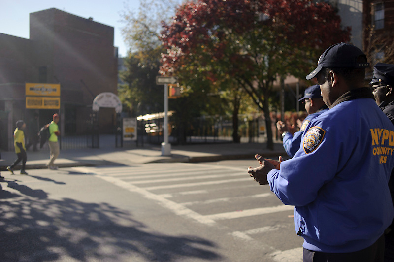 The NYPD watches Maickel pass by and applaud him for his participation in the ING NCY Matahon. November 6th, 2011