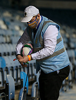 A member of the Leeds United match day staff cleans a ball<br /> <br /> Photographer Alex Dodd/CameraSport<br /> <br /> Carabao Cup Second Round Northern Section - Leeds United v Hull City -  Wednesday 16th September 2020 - Elland Road - Leeds<br />  <br /> World Copyright © 2020 CameraSport. All rights reserved. 43 Linden Ave. Countesthorpe. Leicester. England. LE8 5PG - Tel: +44 (0) 116 277 4147 - admin@camerasport.com - www.camerasport.com