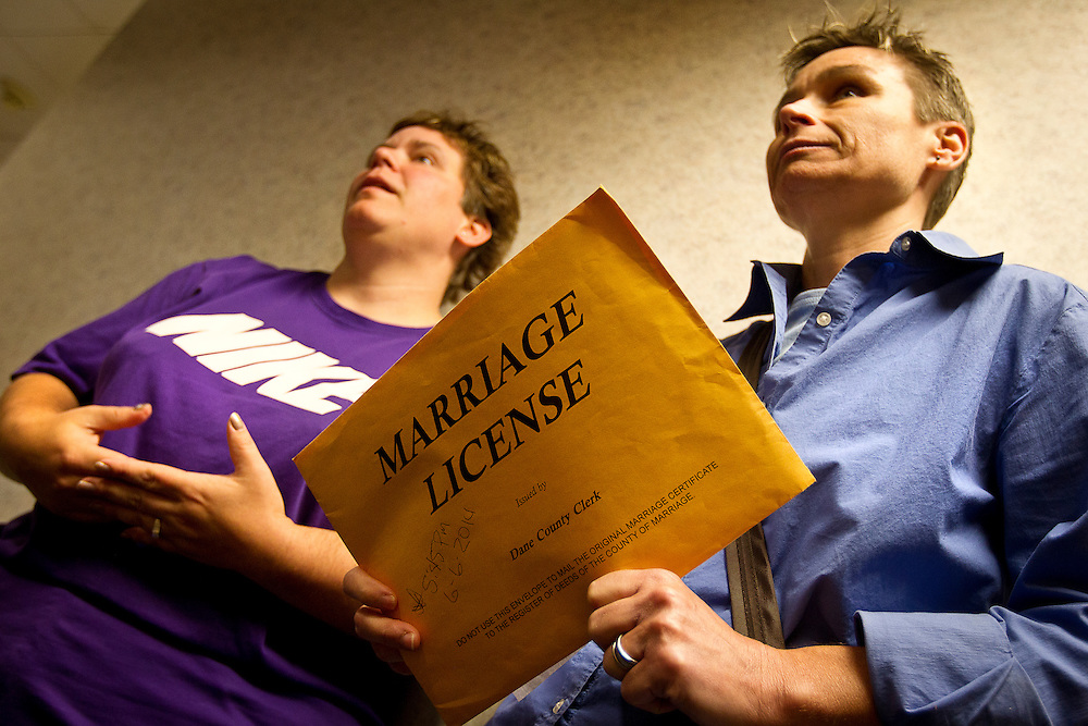 MADISON, WI - JUNE 11, 2014: Shari Roll, right,  holds her certificate of marriage to her wife, Renee Currie, left, at the Dane County Register of Deeds. Currie and Roll were the first same sex couple to be legally wed in the state of Wisconsin on Friday, June 6, 2014.