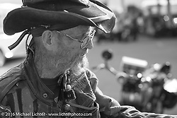 A Cannonball fan checks out all the bikes at a gas stop during Stage 7 of the Motorcycle Cannonball Cross-Country Endurance Run, which on this day ran from Sedalia, MO to Junction City, KS., USA. Thursday, September 11, 2014.  Photography ©2014 Michael Lichter.
