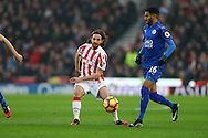 Joe Allen of Stoke City (c)  passes the ball. Premier league match, Stoke City v Leicester City at the Bet365 Stadium in Stoke on Trent, Staffs on Saturday 17th December 2016.<br /> pic by Chris Stading, Andrew Orchard sports photography.