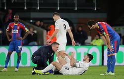 Burnley Robert Brad (bottom, centre) falls on the floor in pain