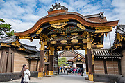 Entrance of Nijo Castle (Nijo-jo), built in 1603 as the Kyoto residence of Tokugawa Ieyasu, the first shogun of the Edo Period (1603-1867). His grandson Iemitsu completed the castle's palace buildings 23 years later and further expanded the castle by adding a five-story castle keep. After the Tokugawa Shogunate fell in 1867, Nijo Castle was used as an imperial palace for a while before being donated to the city and opened to the public as a historic site. Its palace buildings are some of the best surviving examples of castle palace architecture of Japan's feudal era, and the castle was designated a UNESCO world heritage site in 1994.
