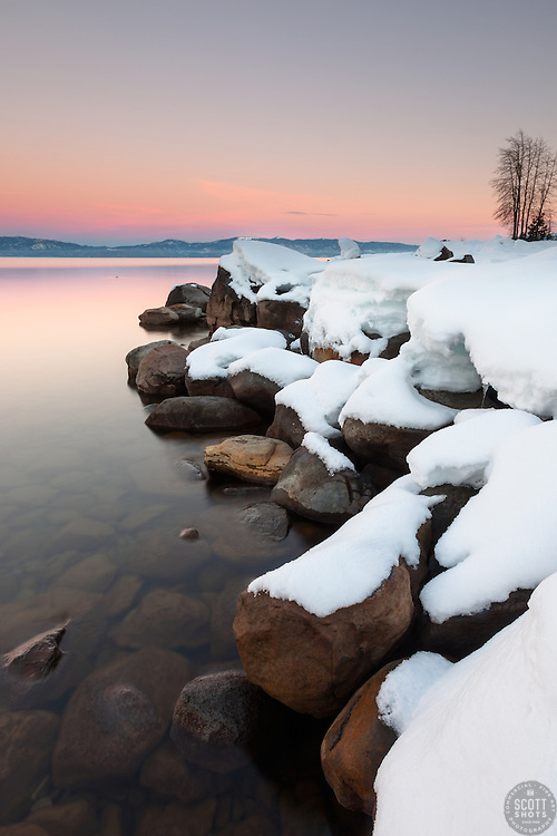 """""""Sunset at Lake Tahoe 33"""" - Photograph at sunset of snow covered boulders along the shore of Lake Tahoe, near Kaspian Point in Hurricane Bay."""