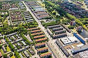 Nederland, Noord-Holland, Amsterdam, 14-06-2012; Burgemeester De Vlugtlaan, levensader van Slotervaart. Rechtsonder markt op Plein '40 - '45. De wijk is onderdeel van de Westelijke Tuinsteden, gerealiseerd op basis van het Algemeen Uitbreidingsplan voor Amsterdam (AUP, 1935). Voorbeeld van het Nieuwe Bouwen, open bebouwing in stroken, langwerpige bouwblokken afgewisseld met groenstroken. ..The residential district Slotervaart, one of the western garden cities of Amsterdam-west..  Constructed on the basis of the General Extension Plan for Amsterdam (AUP, 1935). Example of the New Building (het Nieuwe Bouwen), detached in strips, oblong housing blocks alternated with green areas, built in fifties and sixties of the 20th century. Daily market between the flats (bottom right)..luchtfoto (toeslag), aerial photo (additional fee required).foto/photo Siebe Swart