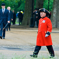 Chelsea Pensioner wearing the famous scarlet coat and tricorne hat in Hyde Park, London