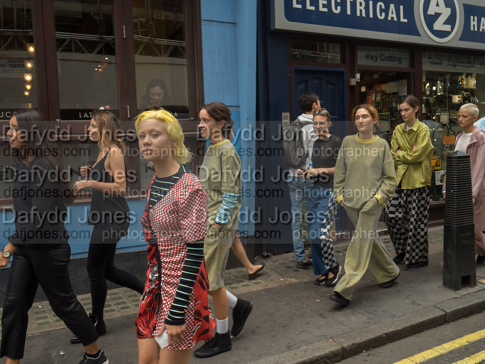 Models from Amo casting modeling clothes by Keji in Soho, September 2016