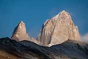 """See Cerro Fitz Roy (3405 meters or 11,171 feet elevation) and Poincenot from Mirador Torre. We hiked 21 km (13 miles) round trip with 730 m (2400 ft) cumulative gain to Laguna Torre and Mirador Maestri to see Cerro Torre and other peaks from El Chalten mountain resort in Santa Cruz Province, Argentina, Patagonia, South America. The village is settled on the riverside of Rio de las Vueltas, within Los Glaciares National Park near the base of Cerro Fitz Roy, at the edge of the Southern Patagonian Ice Field. The town is 220 km north of El Calafate. Chaltén comes from a Tehuelche word meaning """"smoking mountain"""", due to clouds that usually form over Monte Fitz Roy. Los Glaciares National Park and Reserve are honored on UNESCO's World Heritage List."""