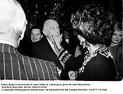 Prince Rupert Loewenstein & Joan Collins at a book party given for John Richardson. M.O.M.A. New York. 20/3/91. Film 91137f36<br />© Copyright Photograph by Dafydd Jones<br />66 Stockwell Park Rd. London SW9 0DA<br />Tel 0171 733 0108
