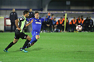 AFC Wimbledon striker Andy Barcham (17)and Bury FC midfielder Neil Danns (16) during the The Emirates FA Cup 1st Round Replay match between AFC Wimbledon and Bury at the Cherry Red Records Stadium, Kingston, England on 15 November 2016. Photo by Stuart Butcher.