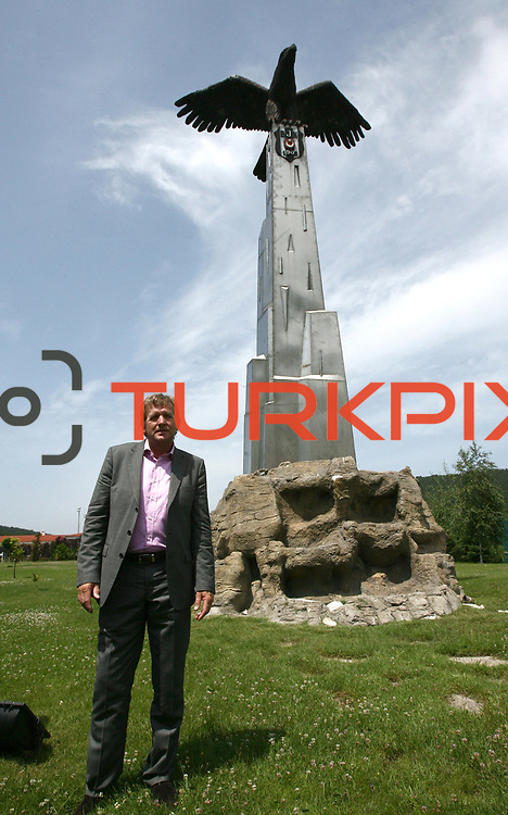 Besiktas Istanbul's soccer club new coach German Bernd Schuster front of an eagle statue, symbol of Besiktas Istanbul, after a signing ceremony in Istanbul, Turkey on 16 June 2010. Schuster signed a two years contract with the Turkish soccer club. Photo by TURKPIX