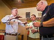 08 JULY 2019 - CRESTON, IOWA: Former Governor JOHN HICKENLOOPER (D-CO) talks to an Iowa voter after a campaign meet and greet in Creston. Hickenlooper is running to be the Democratic nominee in the 2020 Presidential election. At least five staffers left Hickenlooper's campaign last week, including his campaign manager, communications director, digital director and finance director. Hickenlooper named M.E. Smith, who worked on Hickenlooper's successful reelection as Colorado Governor in 2014, as his campaign manager on July 1. Iowa is the first state to hold a presidential selection event in the 2020 election cycle. The Iowa caucuses are February 3, 2020.              PHOTO BY JACK KURTZ