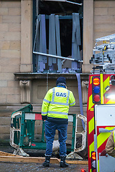 © Licensed to London News Pictures. 07/02/2019. Batley UK. A Gas worker asses the damage after a suspected gas explosion in Batley. At least five people have been hurt in a suspected gas explosion at a two storey building which is a block of converted flats on Hick Lane in Batley, Yorkshire  Photo credit: Andrew McCaren/LNP