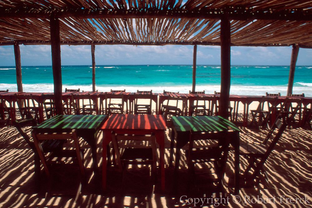 MEXICO, YUCATAN, QUINTANA ROO, TOURISM Caribbean coast with rustic beach front cafe over-looking the sea south of Tulum