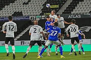 Matthew Clarke of Derby County (16)  heads the ball clear  during the EFL Sky Bet Championship match between Derby County and Cardiff City at the Pride Park, Derby, England on 28 October 2020.