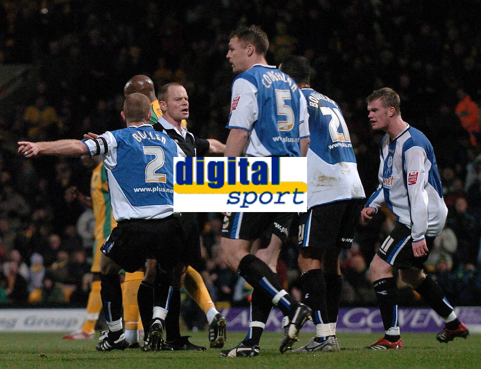 Photo: Ashley Pickering.<br />Norwich City v Sheffield Wednesday. Coca Cola Championship. 09/12/2006.<br />Sheffield players protest to the ref after he awards a penalty for hand ball. He later changed this decision after the linesman flagged for off side.