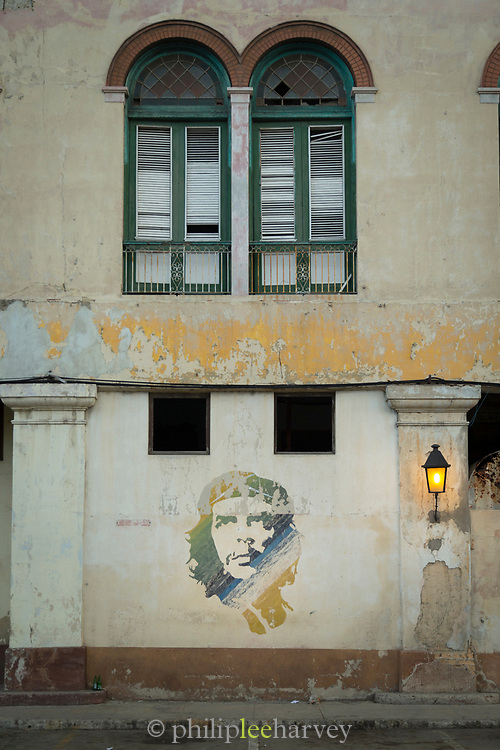 City street with mural with Che Guevara on wall, Havana, Cuba