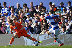 Blackpool's defender Jack Robinson and QPR's defender Aaron Hughes compete for the ball - Photo mandatory by-line: Mitchell Gunn/JMP - Tel: Mobile: 07966 386802 29/03/2014 - SPORT - FOOTBALL - Loftus Road - London - Queens Park Rangers v Blackpool - Championship