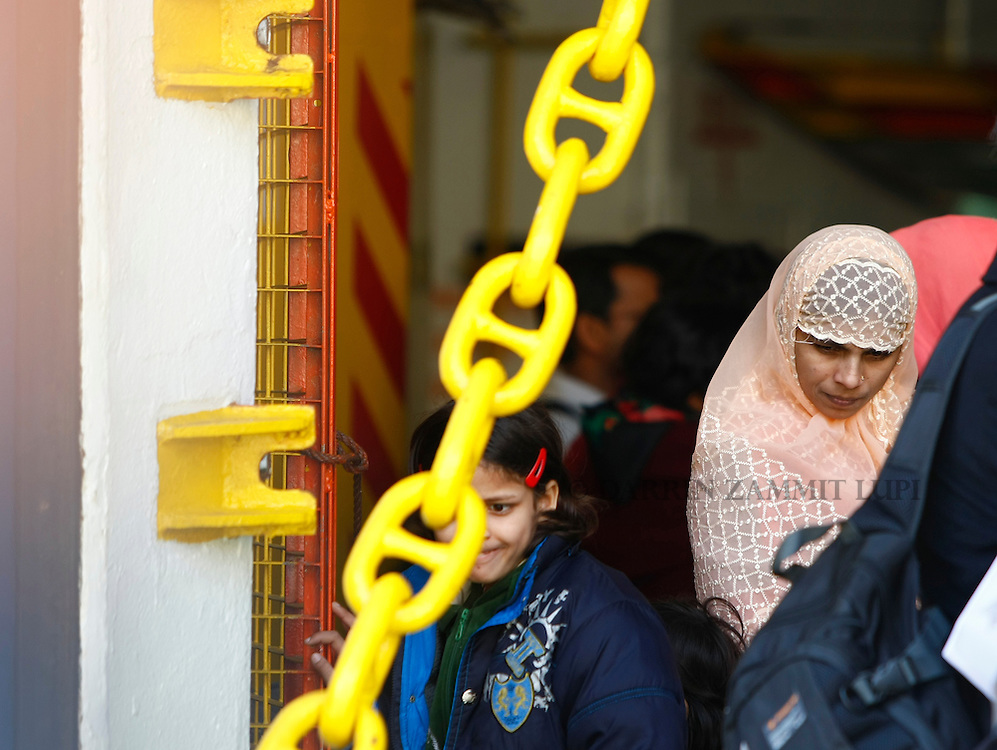 Indian evacuees from Misurata in Libya wait to disembark from the ferry MV Red Star One after arriving at Valletta's Grand Harbour March 6, 2011.  The Indian-chartered ferry arrived in Malta on Sunday morning carrying 301 passengers, mostly Indians but also including Filipino, British and Bangladeshi nationals...REUTERS/Darrin Zammit Lupi (MALTA)