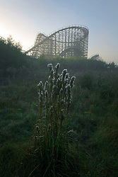 24th November 2010. New Orleans, Louisiana, USA. <br /> <br /> Not amusing any more. <br /> <br /> 'Closed for storm.' Six Flags amusement park radiates an eerie post apocalyptic sense of foreboding in it's abandonment. The park was destroyed by hurricane Katrina , stripped by copper thieves and is slowly being reclaimed by the land it stands on. It is slated for demolition in January 20111 following a lease dispute between the City and Six Flags. The old rollercoater looms large in the early morning mist.<br /> Photo; Charlie Varley/varleypix.com