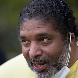 Rev. William Barber II of Goldsboro, N.C. talks to the crowd as voting rights  groups march toward the Texas Capitol from north Austin on the third day of a 30-mile journey protesting Republican efforts to suppress votes nationwide and in Texas. Shifts of marchers trade off in an effort to combat oppressive Texas heat.