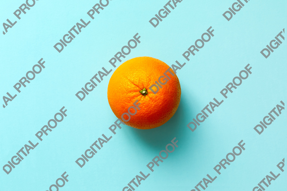 Fresh orange fruit isolated on blue background viewed from above, flatlay style.  Close-up.