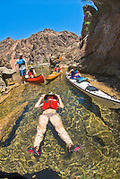 Paddlers at the mouth of The Nevada Hot Springs, The Black Canyon, Nevada.
